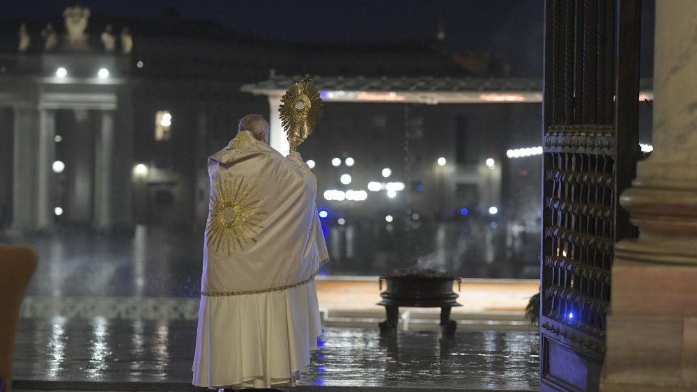 Pope Francis blesses the world with the Blessed Sacrament