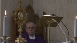 Pope Francis praying before the Blessed Sacrament during Mass at the Casa Santa Marta, 30 March 2020