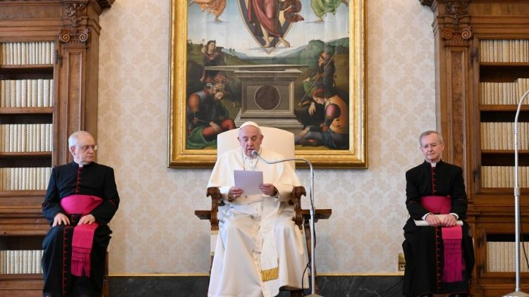 Pope Francis during a General Audience in March, livestreamed from the Library of the Apostolic Palace