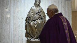 Pope Francis with a statue of Our Lady during Mass at the Casa Santa Marta