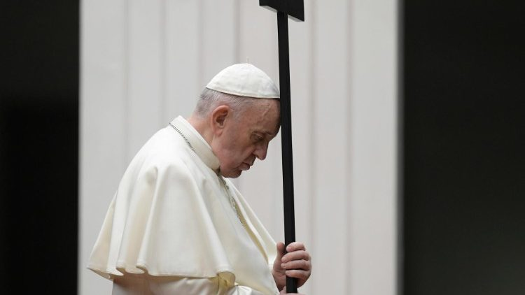 Pope Francis holding the cross during Friday evening's Via Crucis