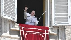 Pope Francis waves to the crowd in St. Peter's Square