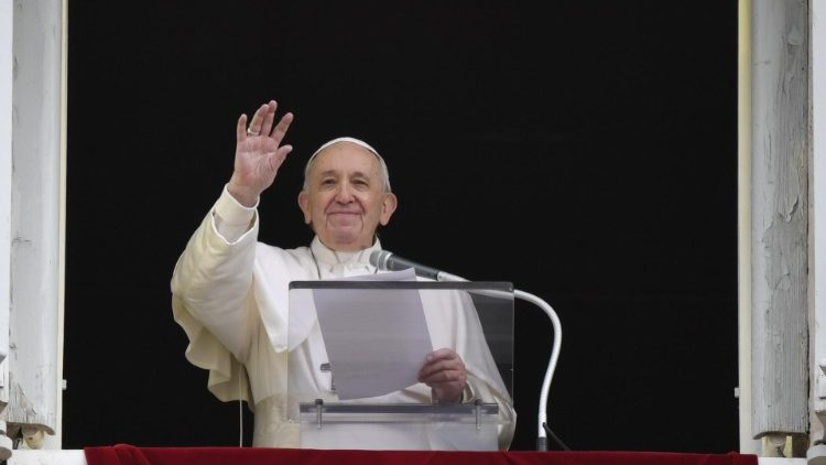 Pope Francis waves to the faithful at the Sunday Angelus