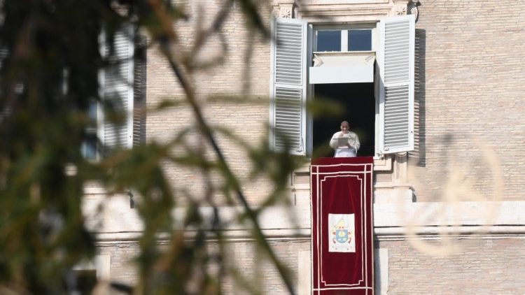Pope Francis prays the Angelus from the window of the Apostolic Palace