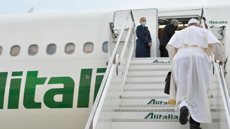 Pope Francis boards the papal plane at Rome's Fiumicino airport