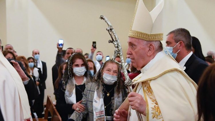 The Pope processes into St. Joseph's Chaldean Cathedral