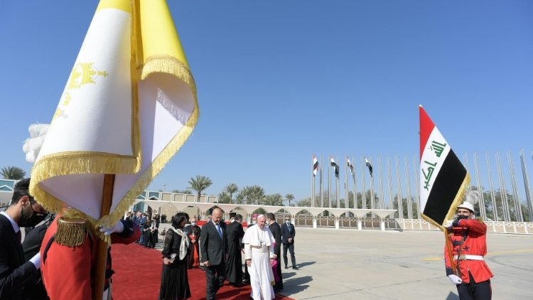 Pope Francis walks to the papal plane at Baghdad airport
