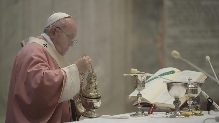 Pope Francis incenses the altar