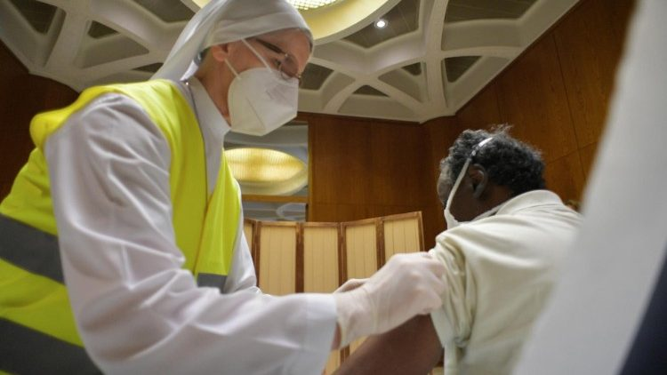 Health-care worker distributing vaccines at the Vatican