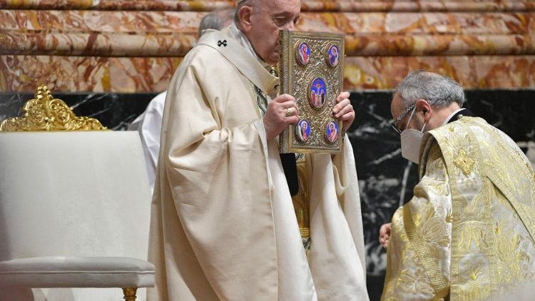 Pope Francis kisses the Book of the Gospels