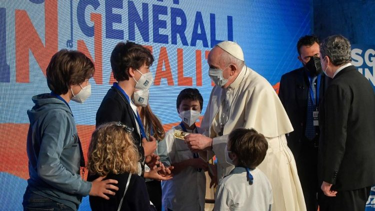 Pope Francis greets children at the conference