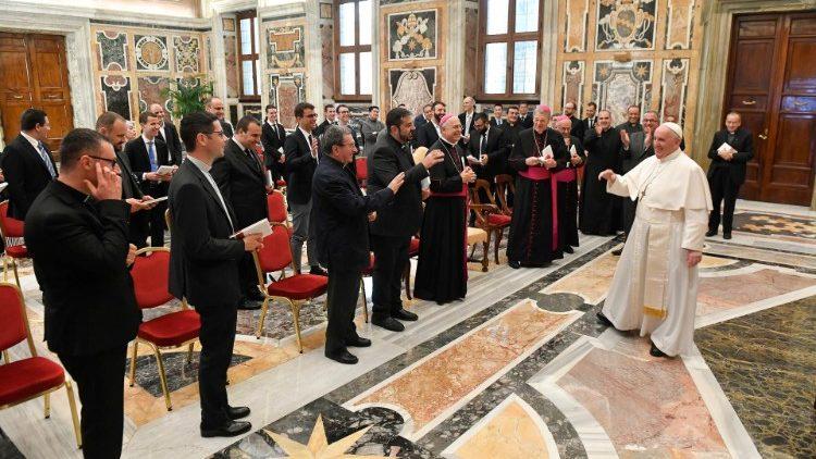 Pope Francis greets seminarians from the Pio XI Seminary in Ancona, Italy