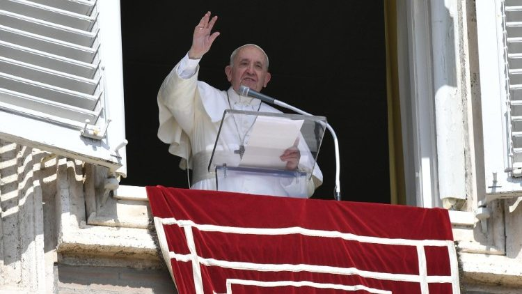 Pope Francis greets the faithful from the window of the Apostolic Palace