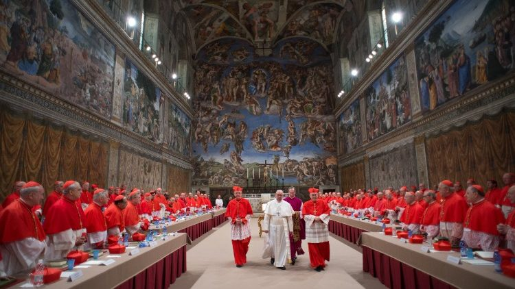 Cardinals and Pope Francis  in the Sistine Chapel
