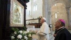 Pope Francis prays before an icon of Mary in Bari's Cathedral on Saturday