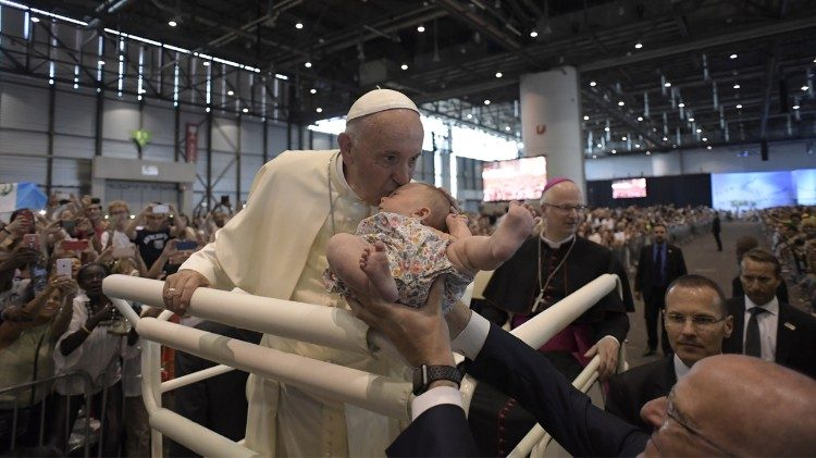 Pope Francis greets the faithful at Geneva's Palexpo Convention Center