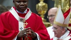 Cardinal Dieudonne Nzapalainga concelebrates Holy Mass with Pope Francis in Bangui Cathedral during the Pope's apostolic visit in November 2015