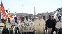 Pope Francis with a group of refugees in St. Peter's Square