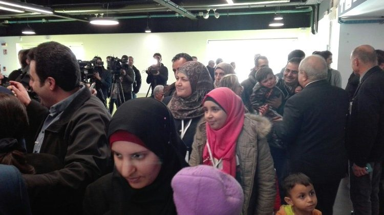 Syrian refugees arrive at Rome's Fiumicino airport as part of a program sponsored by the Community of Sant' Egidio.