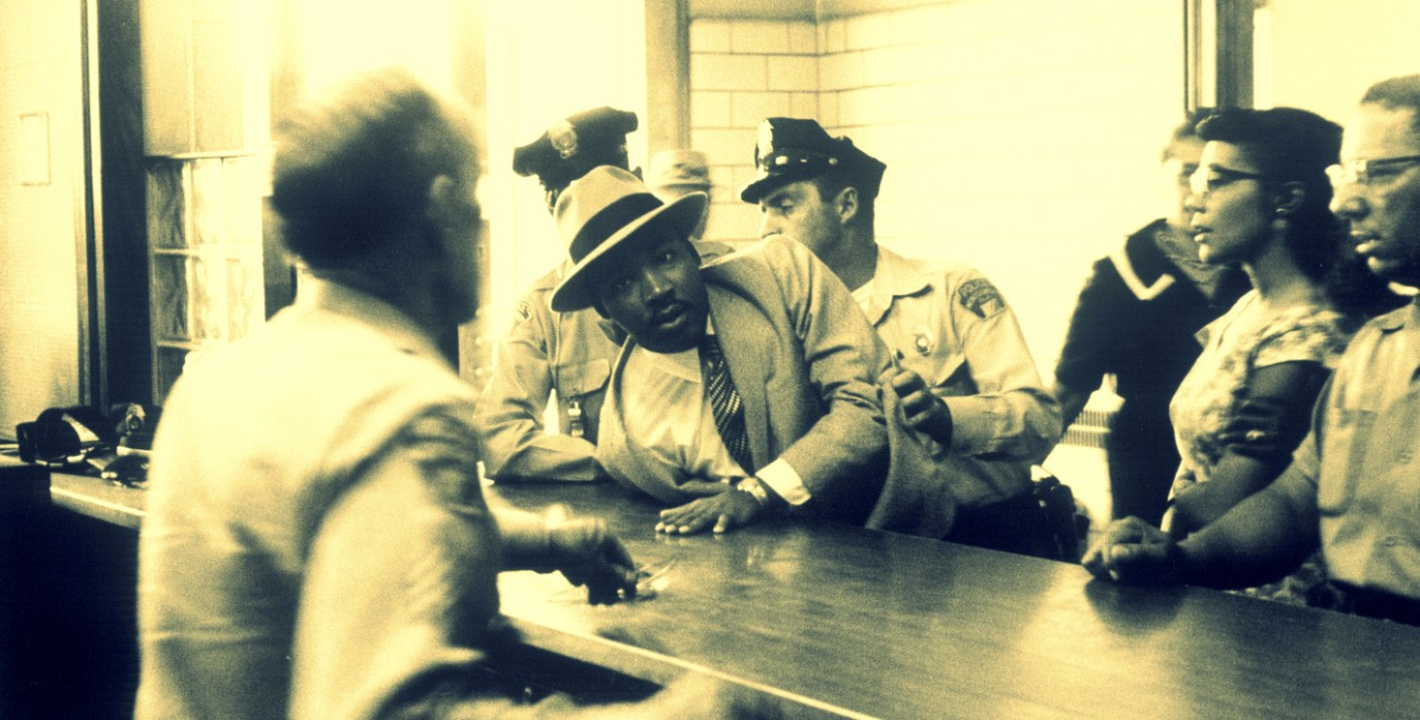 Martin Luther King being arrested for loitering at Montgomery Courthouse in 1958