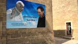 A poster of Pope Francis and Bishop Tonino Bello in Alessano.