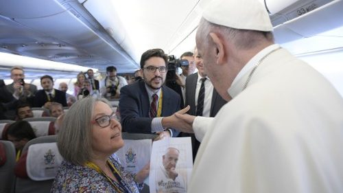 Journalists Cindy Wooden and Joshua McElwee present the Pope with the cover design for their book 'A Pope Francis Lexicon'
