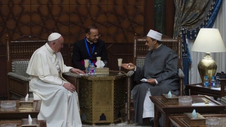 Pope Francis talks with Grand Imam Ahmed el-Tayeb of al-Azhar university in Cairo