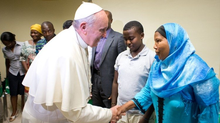 Pope Francis greets refugees in Rome