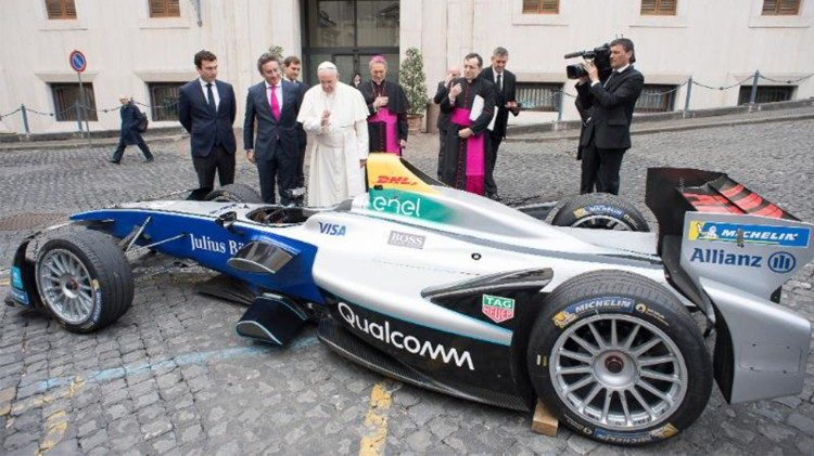 Pope Francis blesses one of the electric racing cars that will compete in the Formula E race in Rome on 14 April