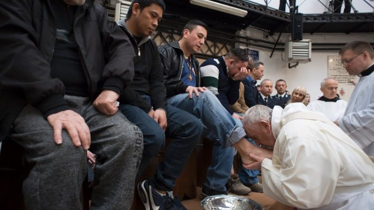Pope Francis washes the feet of prisoners during the Mass for Holy Thursday.