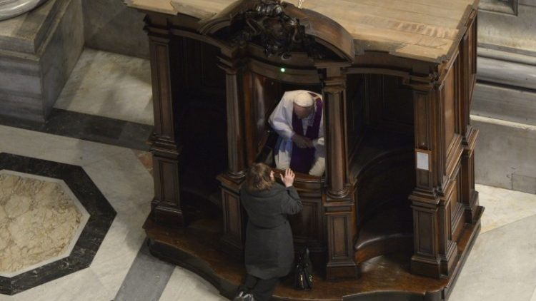 Pope Francis hears confessions during the Pentitential Service in St Peter's Basilica
