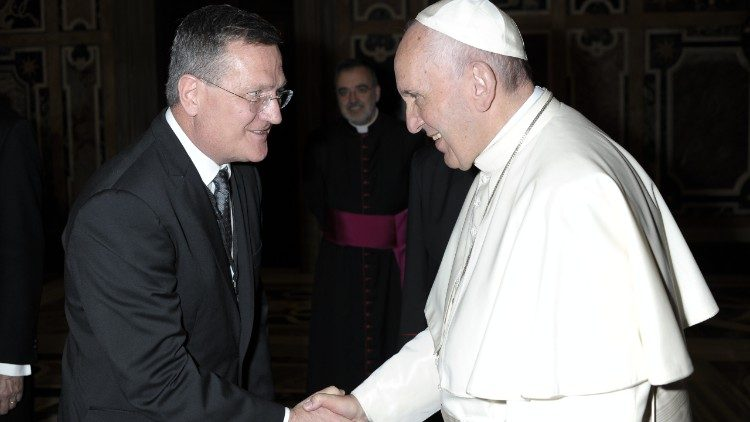 Pope Francis shakes hands with Brian Grim