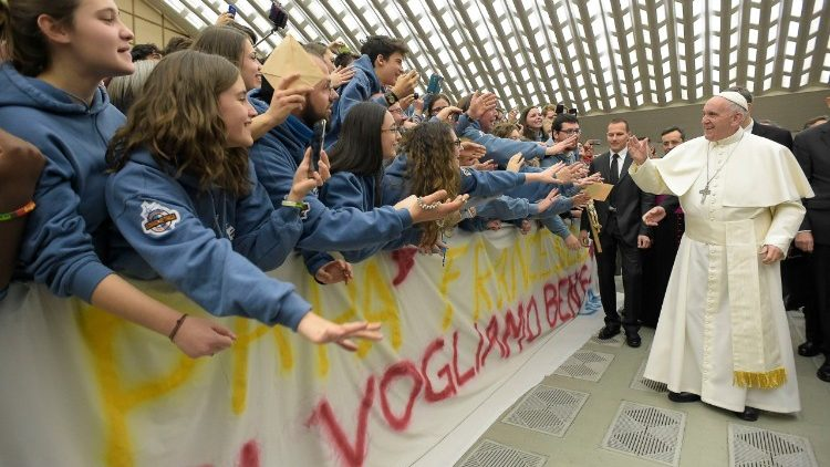 Pope Francis greets young people at his general audience.