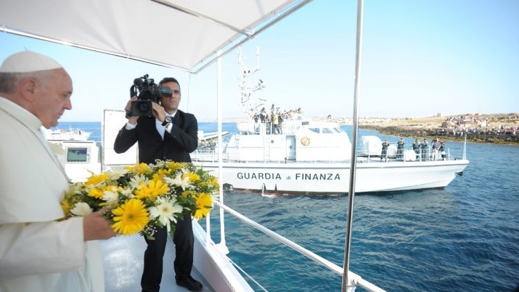 Pope Francis throws a wreath of flowers into the sea at Lampedusa on 8 July 2013