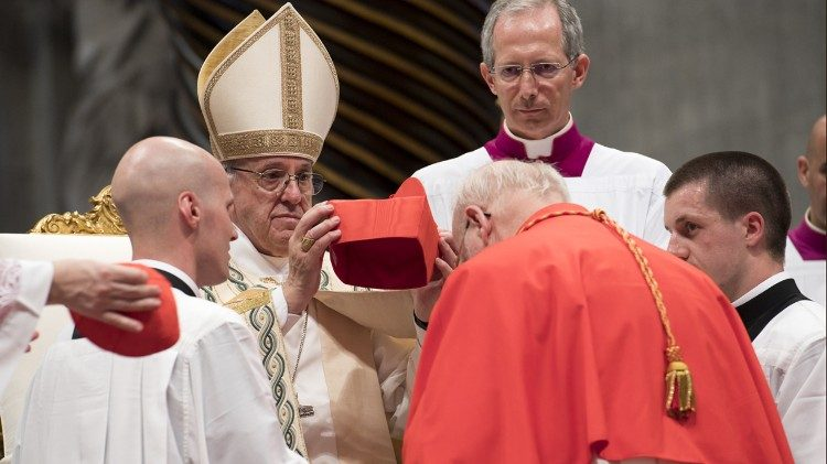 Pope Francis placing the red hat on a new cardinal during the Consistory of June 28, 2017.