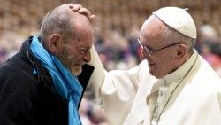 Pope Francis consoling a poor man.