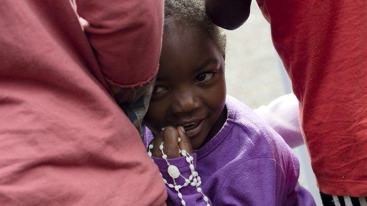 File picture of a child waiting for Pope Francis on his visit to Africa in 2015