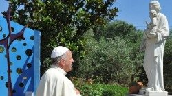 Pope Francis prays before a statue of St Joseph (file photo)