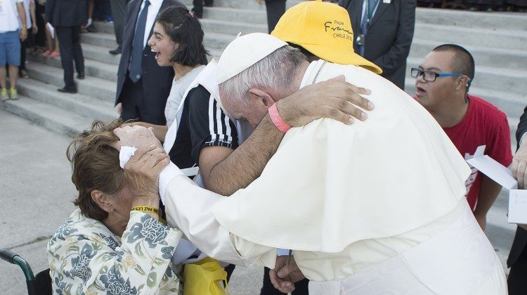 Pope meeting a sick person and her caregiver in Chile in January 2018.