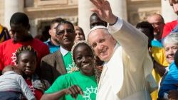 Pope Francis greeting migrants and refugees during a General Audience