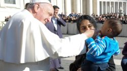 Pope Francis greeting a disabled child.