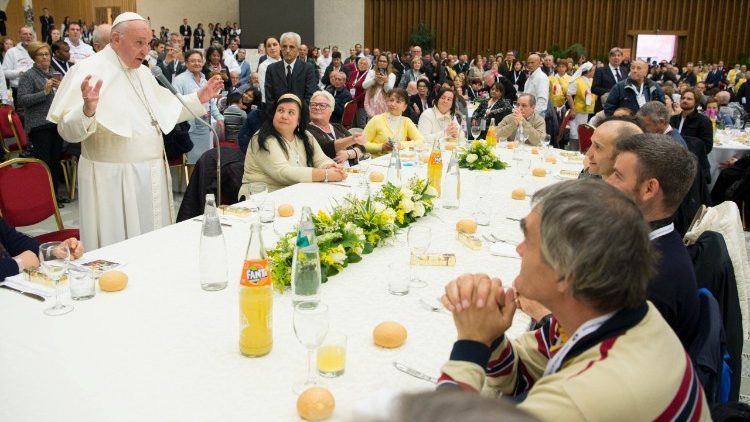 Pope Francis eating with the poor on the World Day of the Poor
