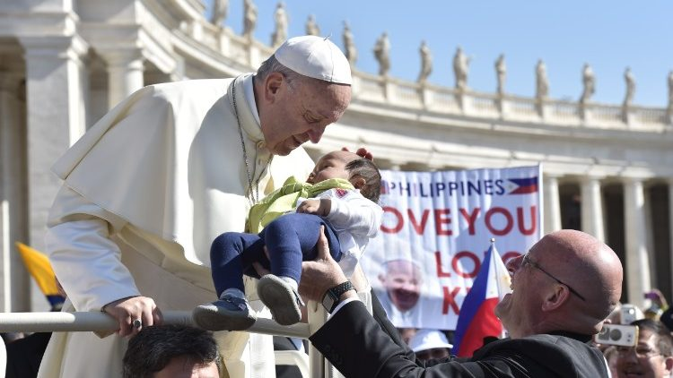 Pope Francis greeting pilgrims at General Audience in St Peter's Square