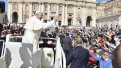 Pope Francis greets pilgrims gathered for the General Audience