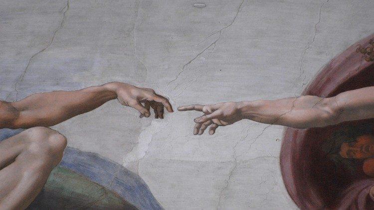 "Fresco de la Capilla Sixtina, ""La creación de Adán""."