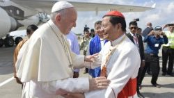 Cardinal Charles Bo (R) welcoming Pope Francis in Yangon, Myanmar, 27 Nov. 2017.