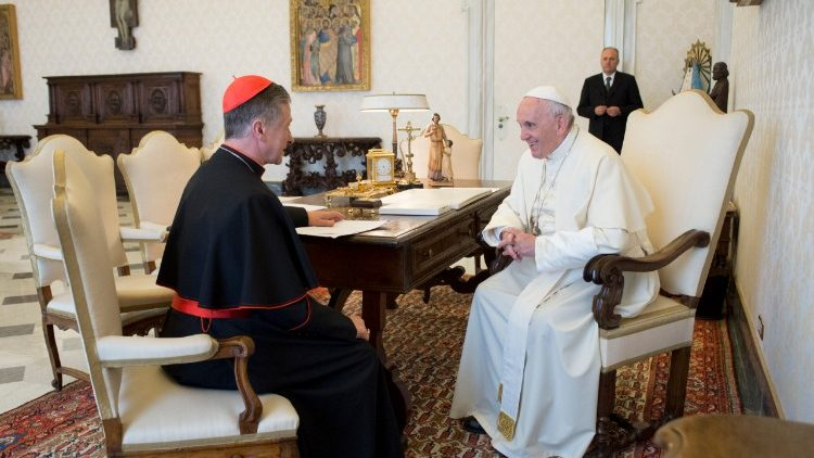 Pope Francis meeting with Cardinal Blase Cupich (file photo)