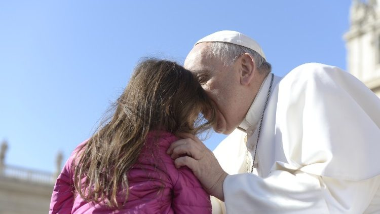 Pope Francis with young girl at his general audience.