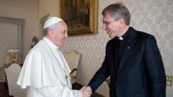 World Council of Churches Secretary General Rev. Olav Fykse Tveit shaking hands with Pope Francis