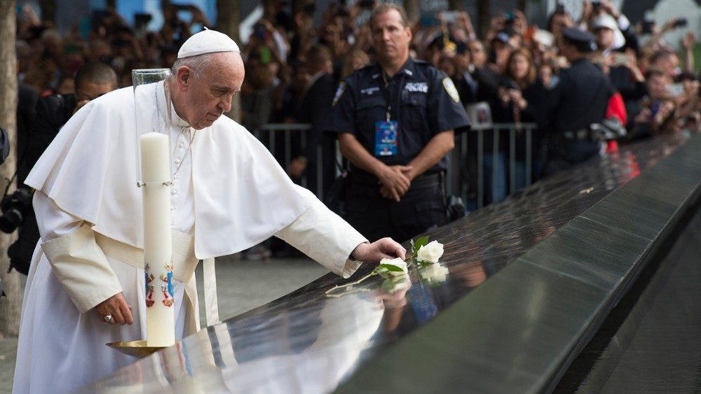Pope Francis lays a white rose at Ground Zero